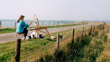 Hetty painting on a dike